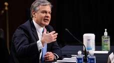 FBI Director Christopher Wray testifies Tuesday about the