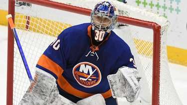 Islanders goaltender Ilya Sorokin protects the net against
