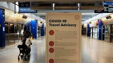 COVID-19 information is displayed at an international terminal