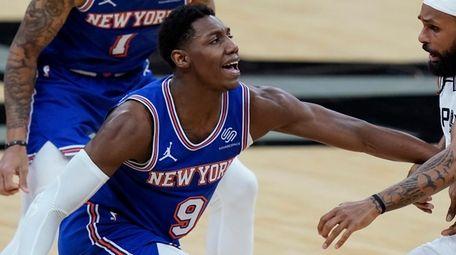 Knicks guard RJ Barrett is defended by Spurs