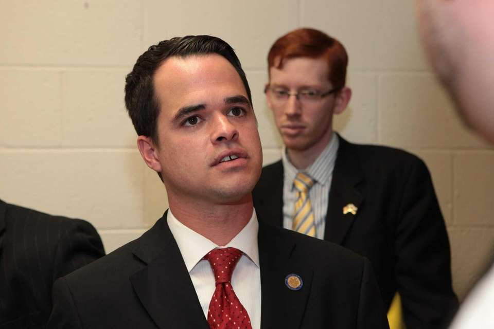 State Sen. David Carlucci speaks with the media