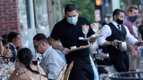 Outdoor dining at Cafe Buenos Aires, with the