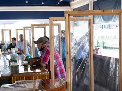 Outdoor dining at Claudio's in Greenport includes precautions