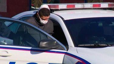 Christopher Cruz is seen leaving the Sixth Precinct