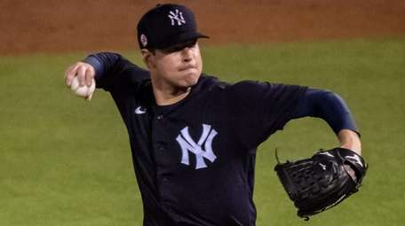 Yankees starting pitcher Corey Kluber throws against the