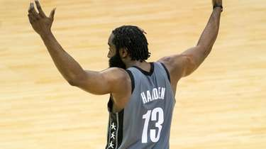 Nets guard James Harden celebrates after an assist