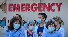 Health care workers watch on April 9, 2020,