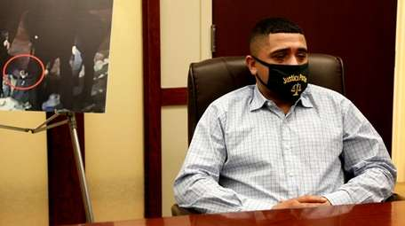 Christopher Cruz sitting at his lawyer's Frederick Brewingtont's