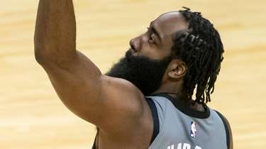 Nets guard James Harden celebrates a three point