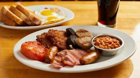 Irish breakfast with bacon, black and white pudding,