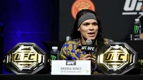 Amanda Nunes of Brazil interacts with media during