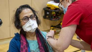 Nipa Shah, of Nesconsset, receives her COVID-19 shot