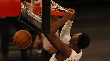 RJ Barrett of the New York Knicks dunks