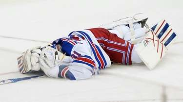 Rangers goaltender Igor Shesterkin lies on the ice