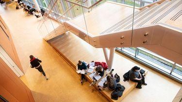 Adelphi University students in the Nexus Building on