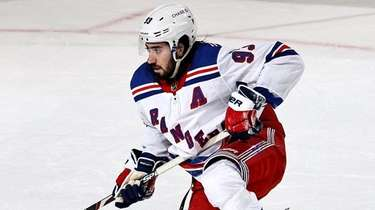 Mika Zibanejad of the Rangers gets up slowly