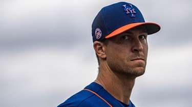 The Mets' Jacob deGrom looks on during a
