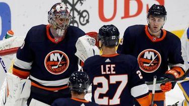 Semyon Varlamov of the Islanders celebrates with his