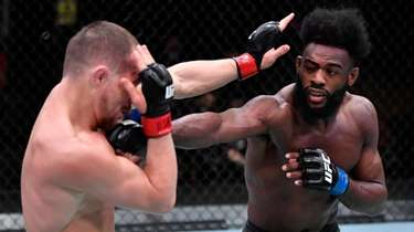 Aljamain Sterling punches Petr Yan in their bantamweight