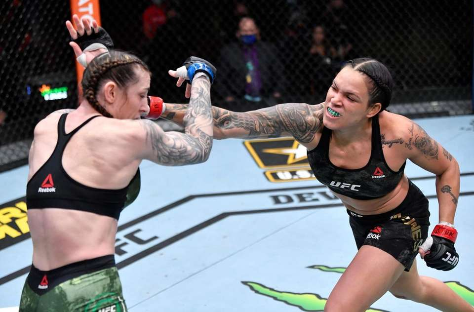 Amanda Nunes of Brazil punches Megan Anderson of