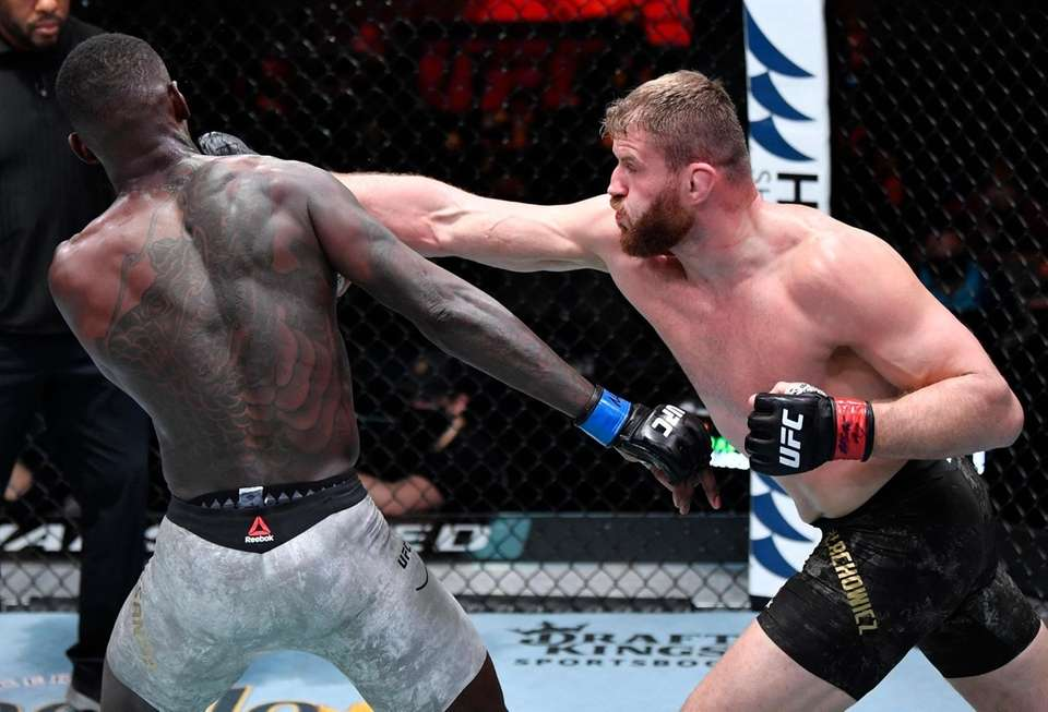 Jan Blachowicz of Poland punches Israel Adesanya of