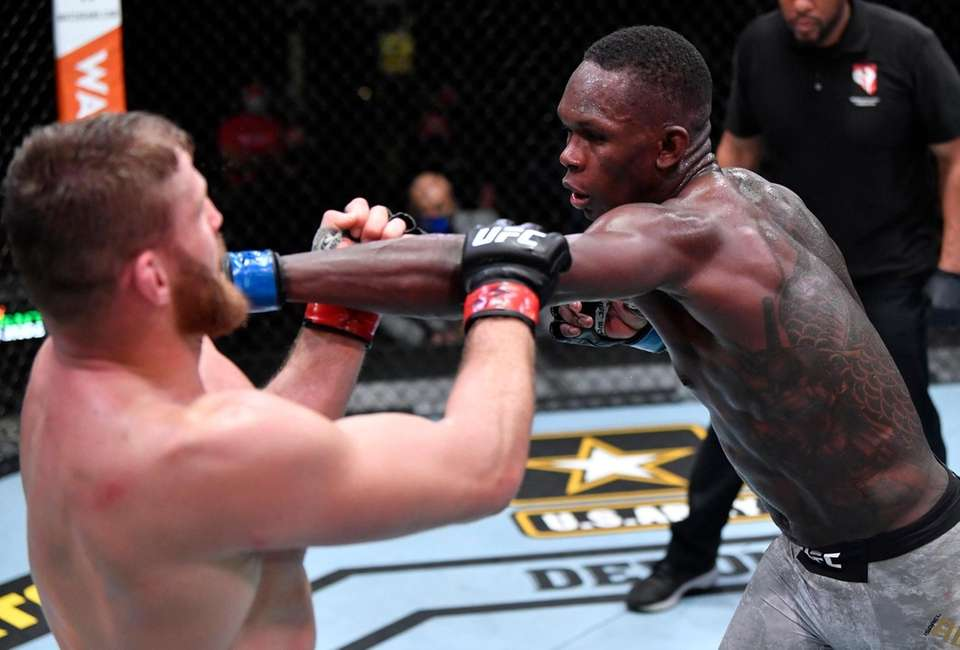 Israel Adesanya of Nigeria punches Jan Blachowicz of