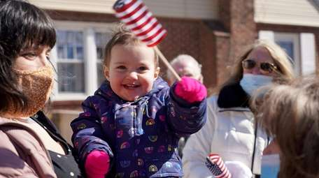 Thea Krolikowski, almost 2-years-old, waves an American flag