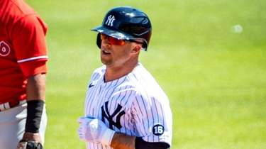 Yankees' Brett Gardner rounds the bases after hitting