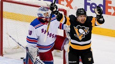 Pittsburgh Penguins' Evan Rodrigues (9) celebrates after John