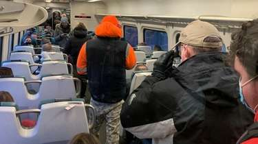 A crowded LIRR train car heads from Bellmore