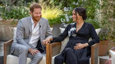 Prince Harry, left, and Meghan, Duchess of Sussex,