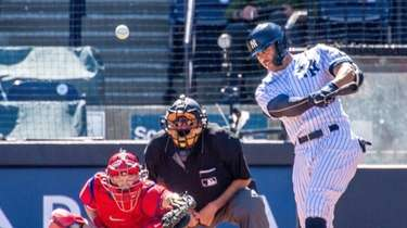 Giancarlo Stanton hits a double during Yankees' exhibition