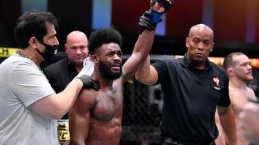Aljamain Sterling reacts after his victory by disqualification