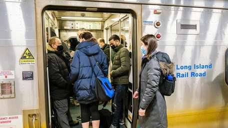 LIRR riders are crowded boarding a train at