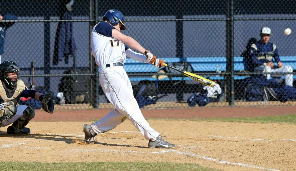 Shoreham-Wading River's Marc Frick drives the ball into