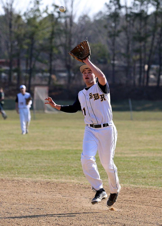 Shoreham-Wading River second baseman Chris Moran grabs the