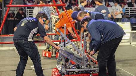 The Oceanside Sailors adjust their robot before the