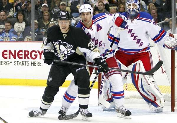 Jussi Jokinen of the Pittsburgh Penguins battles with