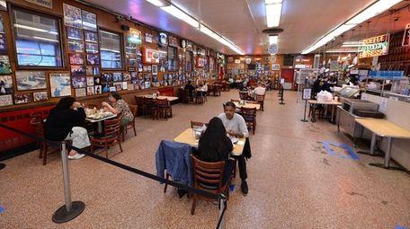 Customers are seated inside Katz Delicatessen on Manhattan's