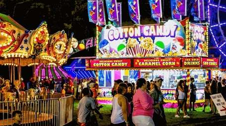 Providing cotton candy, rides, games and entertainment at