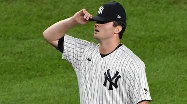 Yankees relief pitcher Zack Britton reacts after the