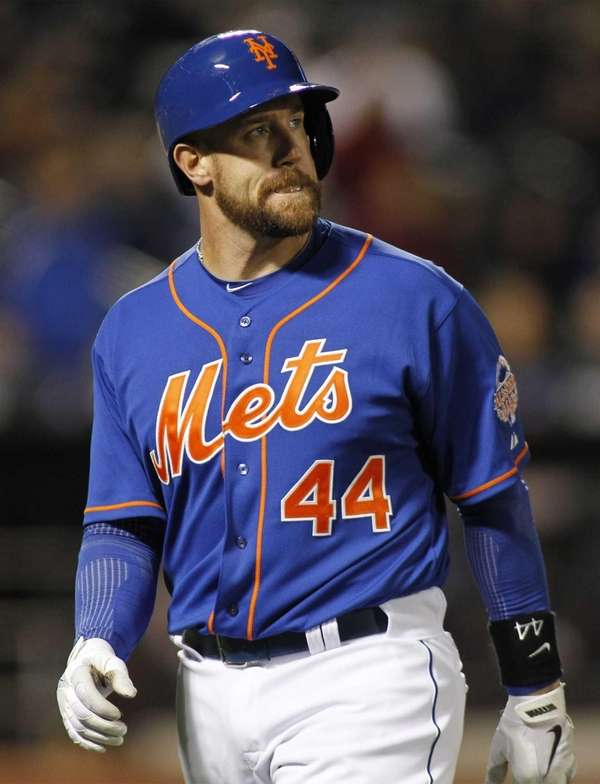 Mets hitter John Buck reacts after flying out