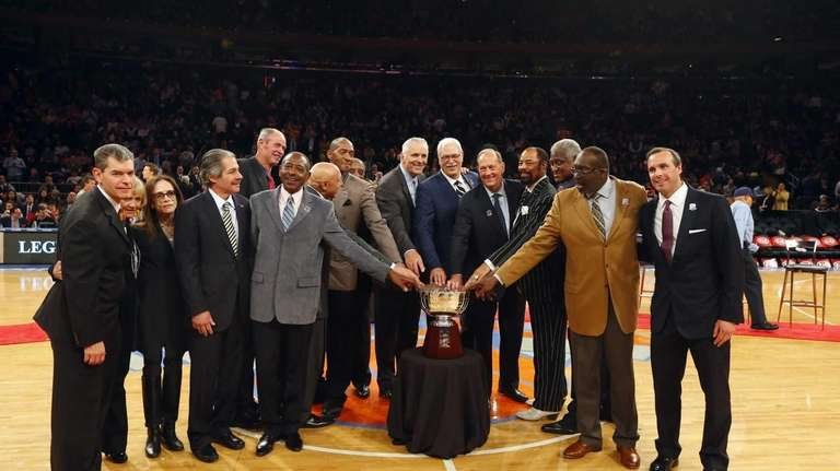 The 1972-73 Knicks pose for a photograph with