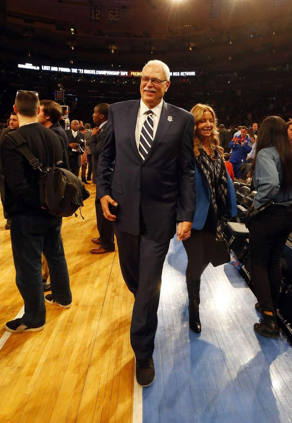 Phil Jackson walks off the court after a