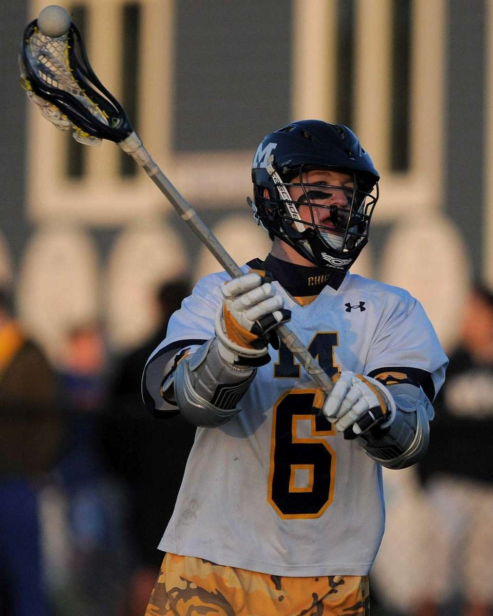 Massapequa's Ian Kirby makes a pass during the