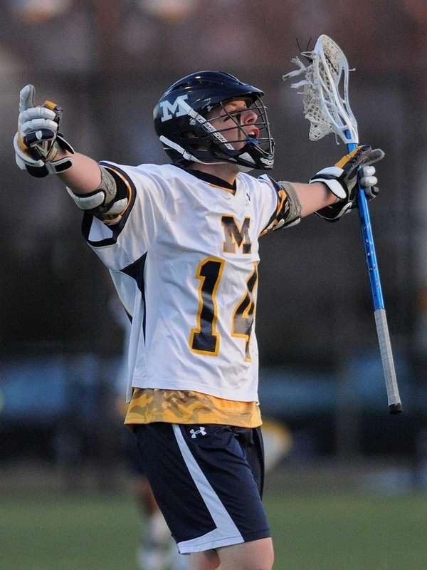 Massapequa's Paul Bentz reacts after a goal by