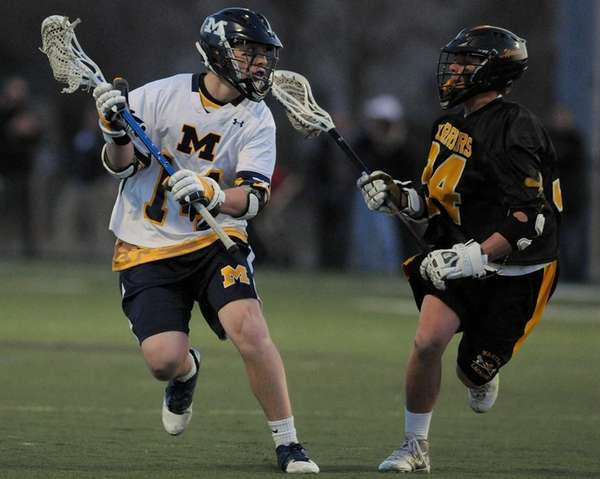Massapequa's Paul Bentz, left, looks to get past