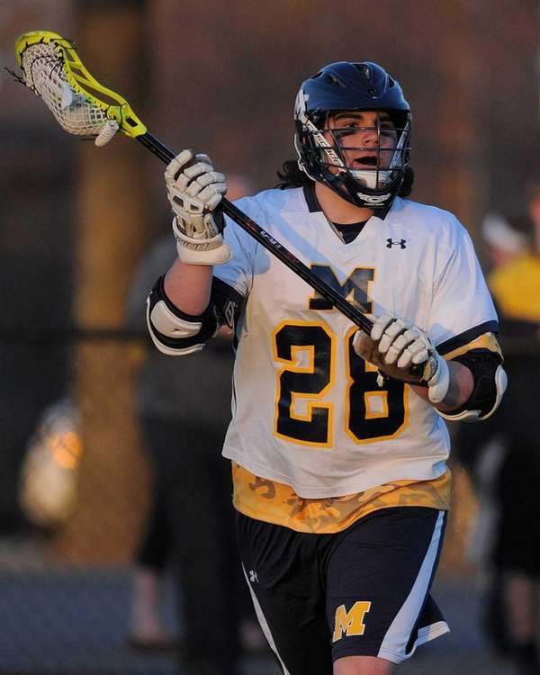Massapequa's Paul Dilena looks to make a pass