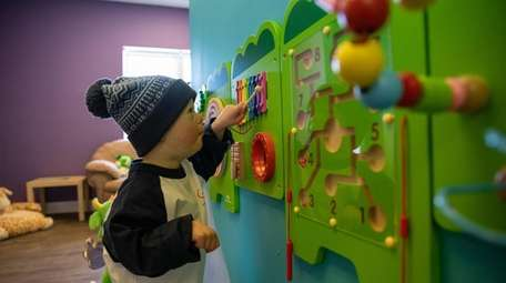 Jude Wood, 2, plays with xylophone toy at