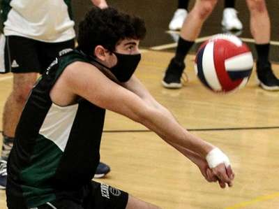 Chase Nussbaum of Bellmore JFK handles a Bethpage